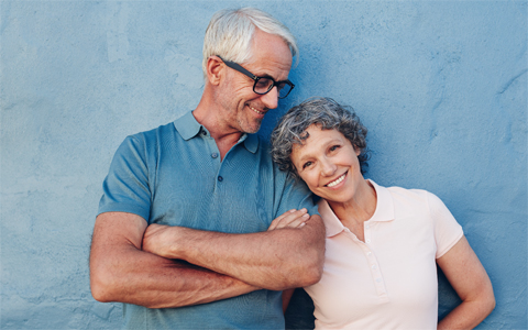 Husband and wife with shining bright white teeth thanks to professional teeth whitening in San Luis Obispo.